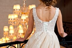 Beautiful white wedding dress with embroidery close-up shot stock images