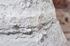 Beautiful white wedding dress with embroidery close-up shot stock photography