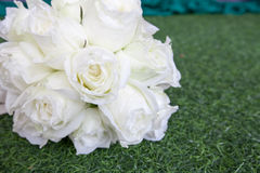 Beautiful white wedding flowers bouquet on the green grass Stock Photography
