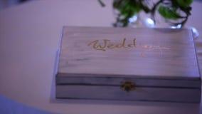 Beautiful white wedding photobook in black wooden box. Wedding concept.  stock footage