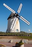 Beautiful white windmill, the background of blue sky. A beautiful white windmill, the background of blue sky royalty free stock photos