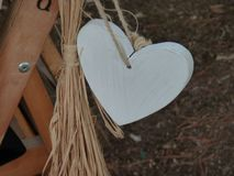 Beautiful white wooden heart stock photos