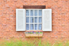 Beautiful white wooden window on brick wall Stock Image