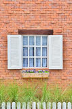 Beautiful white wooden window on brick wall Royalty Free Stock Photo