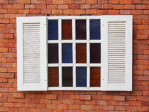 Beautiful white wooden window on old brick wall Royalty Free Stock Photo