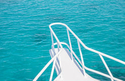 Beautiful white yacht bow on water background. Beautiful white yacht bow on blue water surface background Royalty Free Stock Images