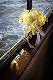 Beautiful White and Yellow Bouquet and Purse. A variety of white and yellow flowers make up this wedding bouquet with diamond and pearl accents with a purse on a Stock Photos
