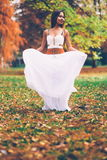 Beautiful wiccan girl dancing in the forest Stock Images