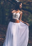 Beautiful wiccan girl dancing in the mystical forest Royalty Free Stock Photography