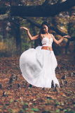Beautiful wiccan girl dancing in the mystical forest Stock Photos