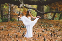 Beautiful wiccan girl dancing in the mystical forest Royalty Free Stock Image