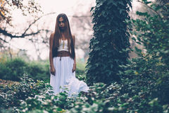 Beautiful wiccan girl, guardian of the mystical forest Stock Photography