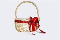 Beautiful wicker basket with red bow isolated on white background Royalty Free Stock Images