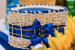 Beautiful wicker box with blue hand made bows. Big beautiful wicker box with blue hand made bows stock image