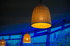 Beautiful wicker lamp on a blue background Stock Images