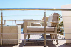 Beautiful wicker table and chair on the balcony of the hotel Royalty Free Stock Photo