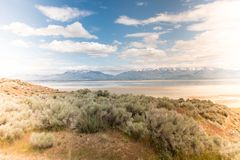 Beautiful wide angle landscape view of salt flats inside of Utah's Antelope Island State Park on Great Salt Lake. Instagram style filter applied for royalty free stock images