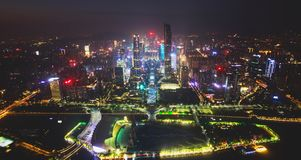 Beautiful wide-angle night aerial view of Guangzhou Zhujiang New Town financial district, Guangdong, China with skyline and scener. Y beyond the city, seen from stock image