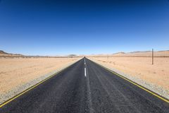 Beautiful wide angle view of the B4 road between Lüderitz and Keetmanshoop near Garub in Namibia, Africa. The road cuts through the famous Namib Desert Royalty Free Stock Photos
