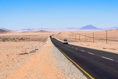 Beautiful wide angle view of the B4 road between Lüderitz and Keetmanshoop near Garub in Namibia, Africa. Beautiful wide angle view of the B4 road between Royalty Free Stock Photos