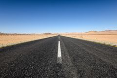 Beautiful wide angle view of the B4 road between Lüderitz and Keetmanshoop near Garub in Namibia, Africa. The road cuts through the famous Namib Desert Stock Image