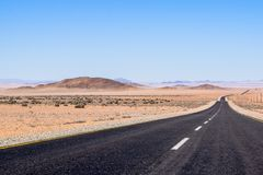 Beautiful wide angle view of the B4 road between Lüderitz and Keetmanshoop near Garub in Namibia, Africa. The road cuts through the famous Namib Desert Royalty Free Stock Photo