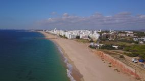 Beautiful wide beaches and white architecture in Quarteira, Algarve, Portugal stock video footage