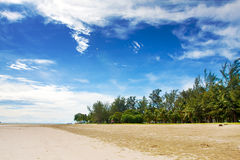 Beautiful wide sandy beach with blue skies Stock Photo