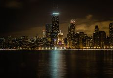 Beautiful wide shot of tall business buildings and skyscrapers of Chicago and the river at night stock images