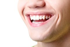 Beautiful wide smile of young man with great healthy white teeth. Isolated over white background stock images