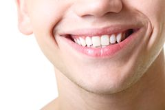 Beautiful wide smile of young man with great healthy white teeth. Over white background stock images