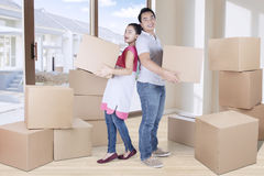 Beautiful wife and husband carry box Royalty Free Stock Photo