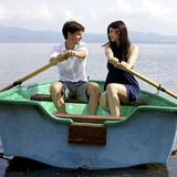 Beautiful wife and husband in love on boat in vacation Royalty Free Stock Images