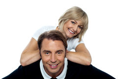 Beautiful wife leaning over her cheerful husband Stock Photography
