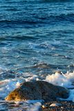 Beautiful wild beach with azure sea, waves on the shore in Tuscany, Italy. stock photography