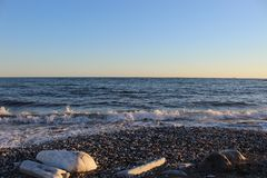 Beautiful wild beach with azure sea, waves on the shore in Tuscany, Italy. Sunny day at the beach stock image
