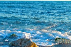 Beautiful wild beach with azure sea, waves on the shore in Tuscany, Italy. Sunny day at the beach stock photo