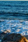Beautiful wild beach with azure sea, waves on the shore in Tuscany, Italy. Sunny day at the beach stock photography