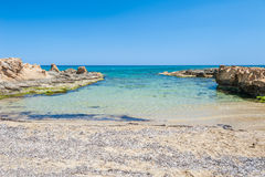Beautiful wild beach with clear turquoise water Stock Photo
