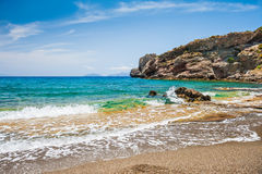 Beautiful wild beach with clear turquoise water and rocks Royalty Free Stock Photos