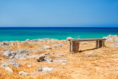 Beautiful wild beach with turquoise water and rocks. Place for relax. Malia, Crete island, Greece. Selective focus Stock Photography