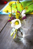 Beautiful wild flowers bouquet in vase. On table Royalty Free Stock Photography