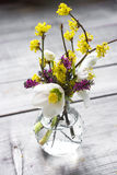Beautiful wild flowers bouquet in vase. On table Stock Photos