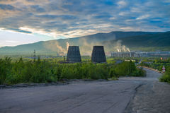 Beautiful and wild tundra of the Arctic in Russia and industrial plant. Works throw their waste into the atmosphere. The beauty of these places could be lost Stock Photography