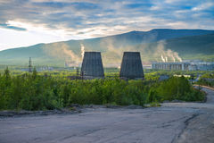 Beautiful and wild tundra of the Arctic in Russia and industrial plant. Works throw their waste into the atmosphere. The beauty of these places could be lost Royalty Free Stock Photos