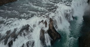 Beautiful wild waterfall Gullfoss from the copter. Aerial view of the turbulent flow in Iceland nature. stock video footage