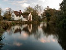 Beautiful willy lotts cottage autumn long exposure blurred water. Constable country flatford mill; suffolk; england; uk Royalty Free Stock Image