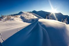Beautiful wind textured snow in cold, windy winter mountain conditions in Siberia. stock images