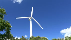 Beautiful Wind Turbines Generating Electricity with blue sky background in Thailand stock video footage