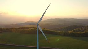 Wind turbines at sunset taken from the drone stock footage